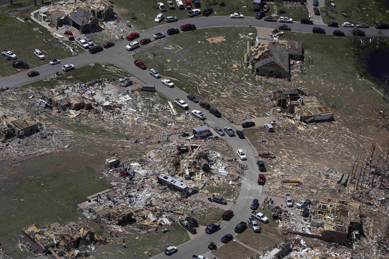 A residential neighborhood is seen destroyed by a tornado in this aerial photograph taken near Vilonia, Arkansas April 28, 2014. A ferocious storm system caused a twister in Mississippi and threatened tens of millions of people across the U.S. Southeast on Monday, a day after it spawned tornadoes that killed 16 people and tossed cars like toys in Arkansas and other states. (REUTERS/Carlo Allegri)