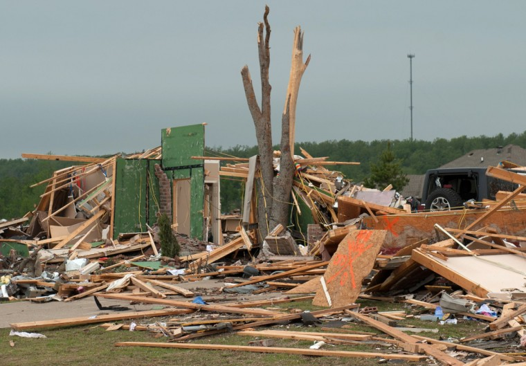 A doorway and shattered tree remain on the grounds of a house a day after a tornado hit the town of Vilonia, Arkansas April 28, 2014. Workers searched for survivors on Monday in the rubble left by a wave of tornadoes that ripped through the south-central United States a day earlier, killing at least 18 people in Arkansas, Oklahoma and Iowa. (Angie Davis/Reuters)