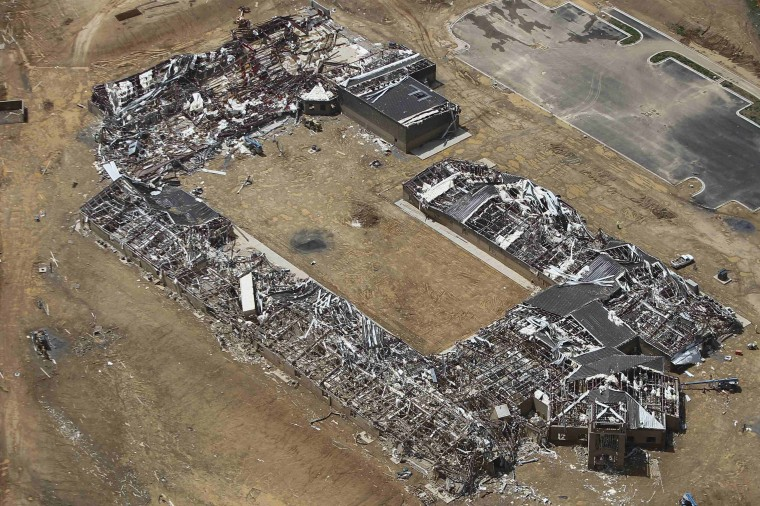 A newly built school is seen destroyed by a tornado in this aerial photograph near Vilonia, Arkansas April 28, 2014. A ferocious storm system caused a twister in Mississippi and threatened tens of millions of people across the U.S. Southeast on Monday, a day after it spawned tornadoes that killed 16 people and tossed cars like toys in Arkansas and other states. (REUTERS/Carlo Allegri)