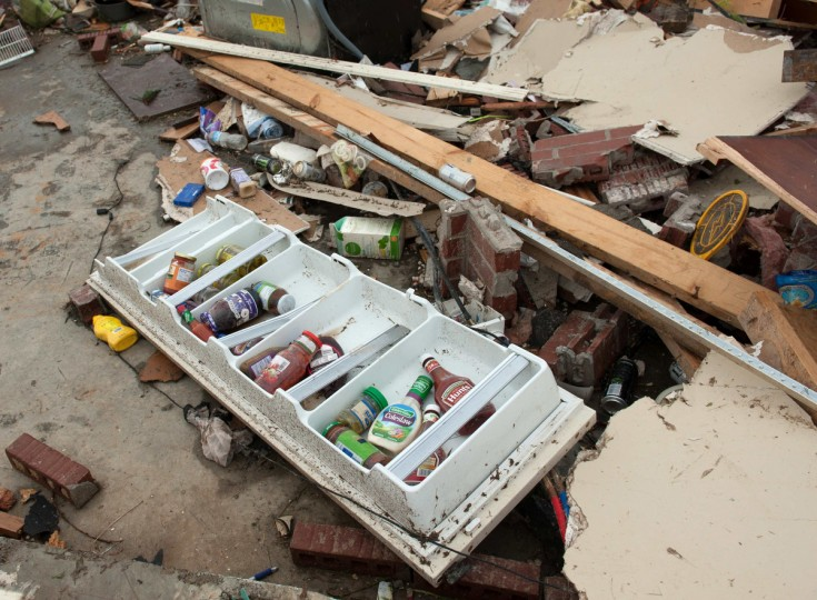 Bottles of condiments lie inside a refrigerator door on the grounds of a destroyed house a day after a tornado hit the town of Vilonia, Arkansas April 28, 2014. Workers searched for survivors on Monday in the rubble left by a wave of tornadoes that ripped through the south-central United States a day earlier, killing at least 18 people in Arkansas, Oklahoma and Iowa. (Angie Davis/Reuters)