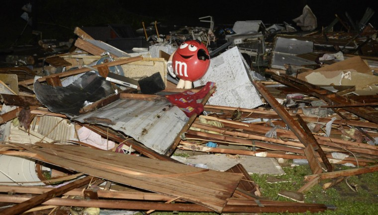 Debris from a damaged home is seen after a tornado hit the town of Mayflower, Arkansas around 7:30 pm CST, late April 27, 2014. Tornadoes ripped through the south-central United States on Sunday, killing at least 12 people in Arkansas and Oklahoma and wiping out entire neighborhoods of homes, according to officials, as rescue workers searched in darkness for survivors. In Mayflower, some of about 45 homes were destroyed in a newer subdivision and a lumberyard was damaged, said Will Elder, an alderman in the city of 2,300 people. (Gene Blevins/Reuters)