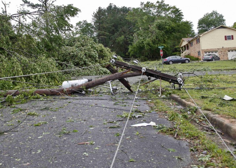 Fallen trees and damaged homes are seen after a tornado hit the town of Bessemer, Alabama, April 29, 2014. At least 30 people across six states have been killed by a vicious storm system that unleashed dozens of tornadoes and was threatening to cause more damage in heavily populated regions of the U.S. South on Tuesday. (Marvin Gentry/Reuters)