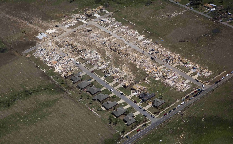 Aerial view of the central town after a tornado hit Vilonia, Arkansas April 28, 2014. A ferocious storm system caused a twister in Mississippi and threatened tens of millions of people across the U.S. Southeast on Monday, a day after it spawned tornadoes that killed 16 people and tossed cars like toys in Arkansas and other states. (REUTERS/Carlo Allegri)