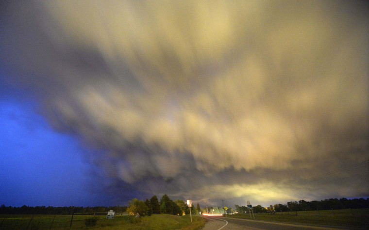 A low-level thunderstorm supercell passes over the area of Hampton, Arkansas late April 24, 2014. A strong storm system, with high winds and torrential rain, is taking shape in the south central United States this weekend and threatens to produce tornadoes, which have been relatively uncommon so far this year, forecasters said on Friday. (Gene Blevins/Reuters)