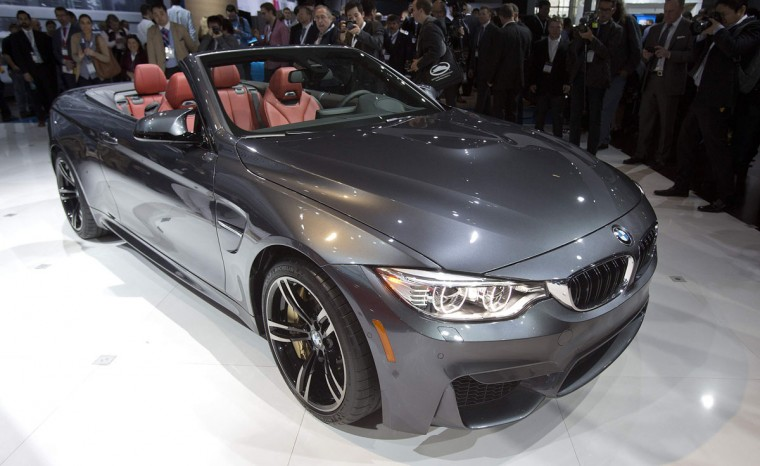 A BMW M4 Convertible is pictured at a media event at the Jacob Javits Convention Center during the New York International Auto Show in New York April 16, 2014. (REUTERS/Carlo Allegri)