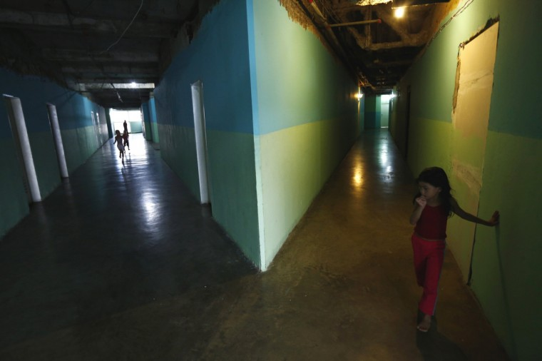 "Children stand along the corridors at the ""Tower of David"" skyscraper. (Jorge Silva/Reuters)"