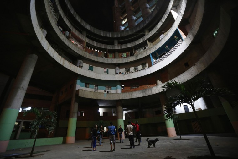 "Children play in the lobby of the ""Tower of David"" skyscraper in Caracas. (Jorge Silva/Reuters)"