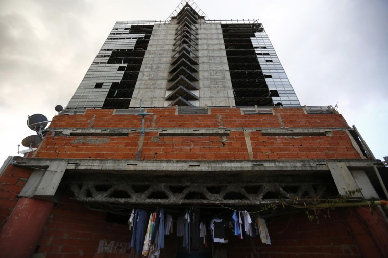"Clothes hang to dry at the top of the ""Tower of David"" skyscraper in Caracas. (Jorge Silva/Reuters)"
