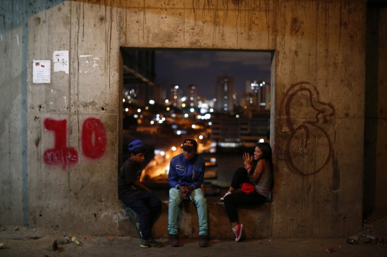 "Teenagers chat on the 10th floor of the ""Tower of David"" skyscraper in Caracas. (Jorge Silva/Reuters)"