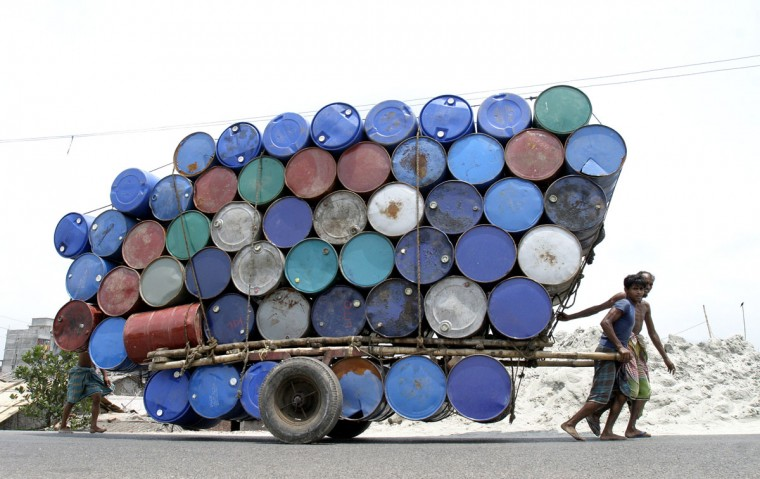 Bangladeshi laborers pull a cart of used containers to the market in Dhaka on April 26, 2007. (REUTERS/Rafiqur Rahman)