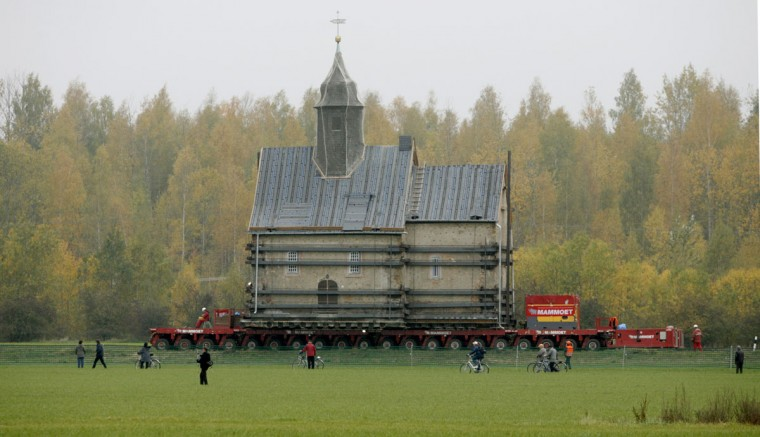 The Emmaus church is transported on a special trailer, after leaving the eastern German village of Heuersdorf on October 25, 2007. (REUTERS/Arnd Wiegmann)