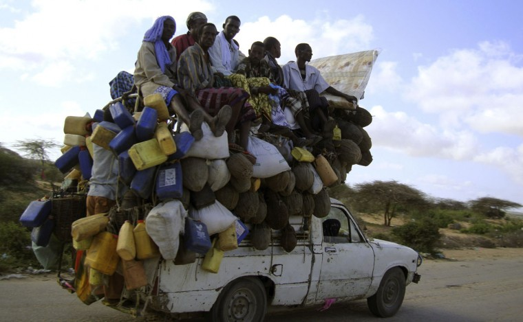 Residents ride on a pick-up truck that supplies milk and other items in Somalia's capital Mogadishu, on September 2, 2009. (REUTERS/Omar Faruk)