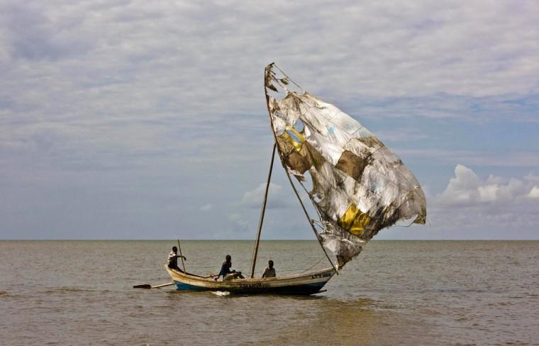 Turkana men sail their fishing boats near the shores of Lake Turkana, northeast of Kenya's capital Nairobi, on August 10, 2011. (REUTERS/Kabir Dhanji)
