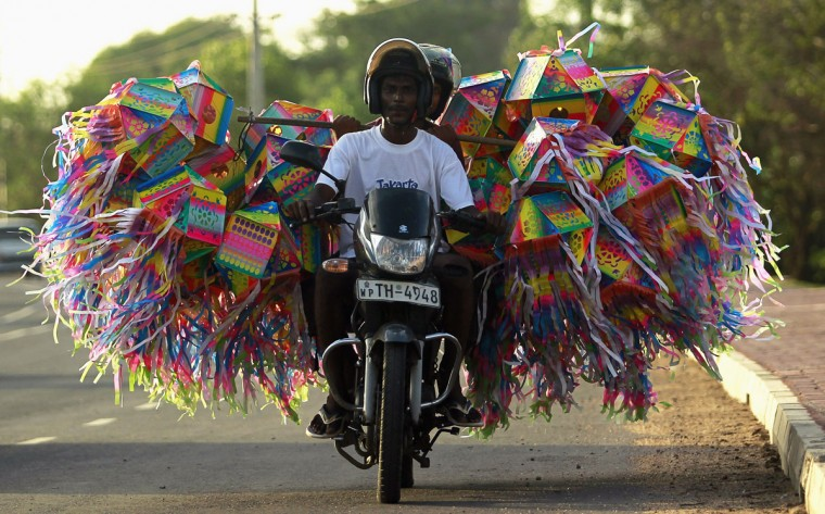 A man transports lanterns for decorations on his motorbike ahead of Vesak Day celebrations in Colombo, Sri Lanka on May 4, 2012. (REUTERS/Dinuka Liyanawatte)