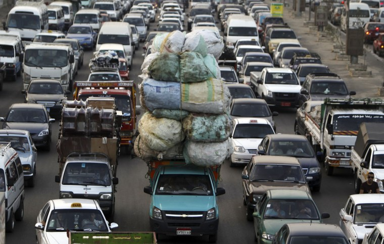 A traffic jam, one of five key issues Egyptian President Mohamed Mursi outlined in his Al Nhada (Renaissance) project, is pictured in old Cairo on October 8, 2012, a day after his 100th day in power. (REUTERS/Amr Abdallah Dalsh)
