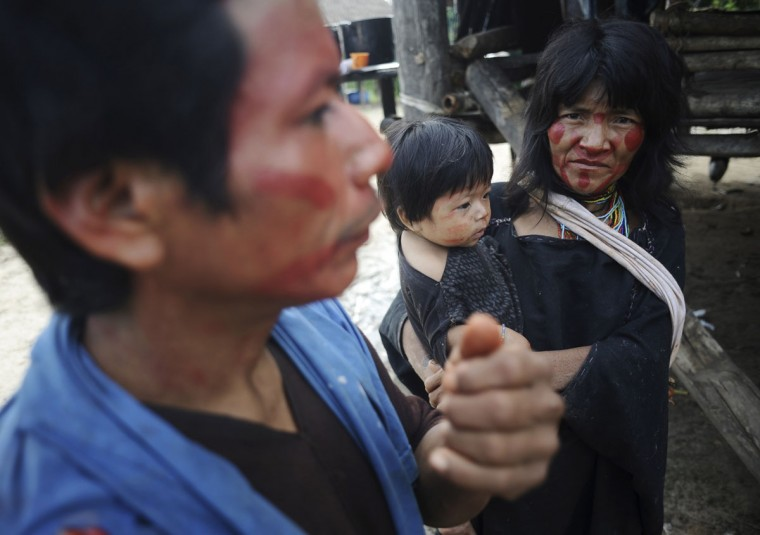Ashaninka Indian couple Poshe and Biana talk about the kidnapping of their daughter Sawatxo, some years ago, by uncontacted Indians, in their village Simpatia, along the Envira river in Brazil's northwestern Acre state. (REUTERS/Lunae Parracho)