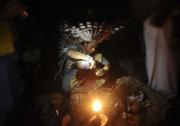 A Huni Kui Indian prepares a drink known as nixi pae or ayahuasca to use in a healing ritual in the village of Novo Segredo along the Envira river of Brazil's northwestern Acre state. (REUTERS/Lunae Parracho)