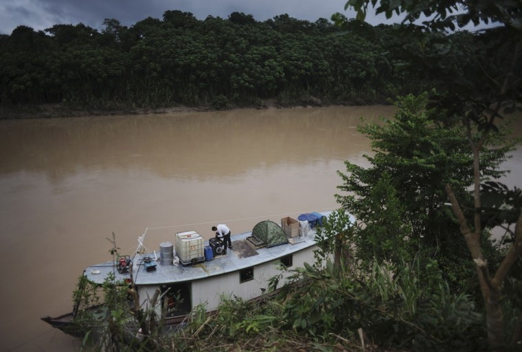 The boat in which Ashaninka Indian leaders travelled to inspect the limits of their territory is tied to the bank of the Envira river in Brazil's northwestern Acre state. (REUTERS/Lunae Parracho)