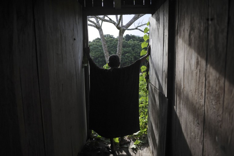 Ashaninka Indian cacique (chief) Txate stands inside a building of the former government base called the Envira Front of Ethno-environmental Protection along the Envira river in Brazil's northwestern Acre state. (REUTERS/Lunae Parracho)