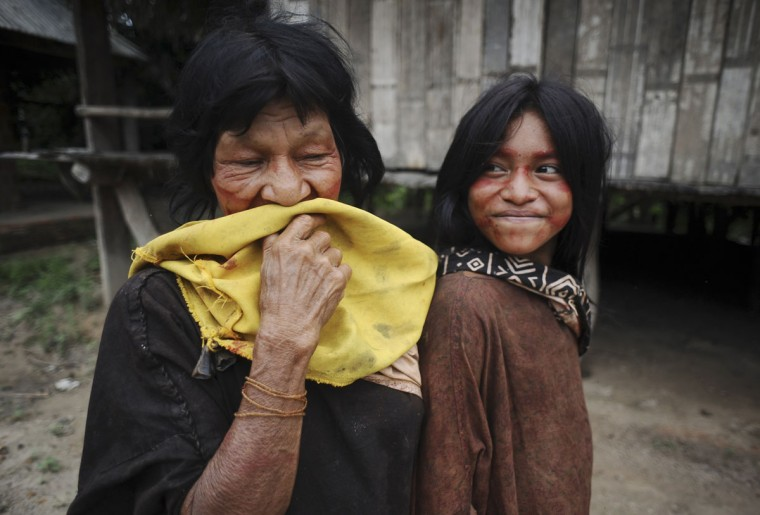 Ashaninka Indians pose for a photograph in the village of Kokasul along the Envira river in Brazil's northwestern Acre state, March 16, 2014. Many indigenous groups, including the Huni Kui, Ashaninka, and Madija, live in villages in the Brazilian rainforest near the border with Peru. (REUTERS/Lunae Parracho)