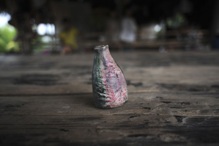 A ceramic flute made by uncontacted Indians sits on a table after it was found by Cacique Omina of the Madija tribe, in the village called Igarape do Anjo in Brazil's northwestern Acre state. (REUTERS/Lunae Parracho)