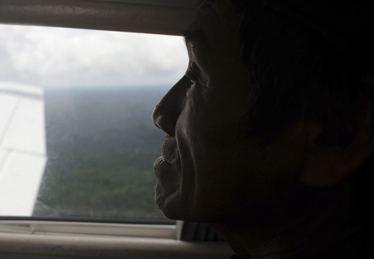 Ashaninka Indian cacique (chief) Txate observes his tribe's territory from a plane window in Brazil's northwestern Acre state. (REUTERS/Lunae Parracho)