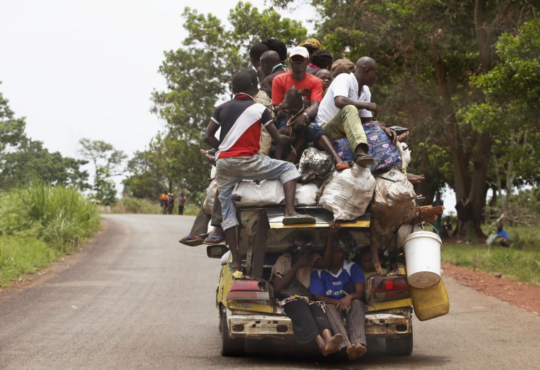 People pile on a vehicle on a road between the village of Zawa and the town of Yaloke in the Central African Republic on April 8, 2014. (REUTERS/Goran Tomasevic)