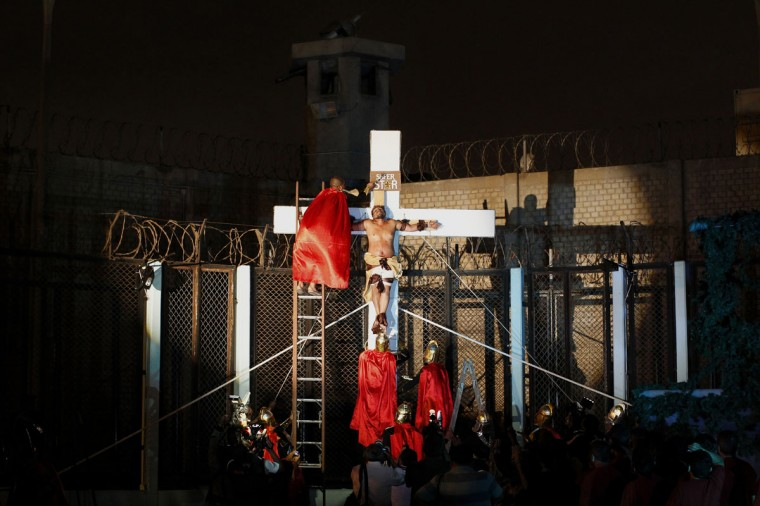 "Inmates perform the theatre play ""Jesus Christ Superstar"" at Sarita Colonia prison yard, ahead of Holy Week celebrations, in Lima, Peru on April 15, 2014. The play was held to encourage the inmates in their rehabilitation process, according to the prison's press release. Sarita Colonia's population is made up of 3,113 inmates, out of which 472 are foreigners. (REUTERS/Enrique Castro-Mendivil)"