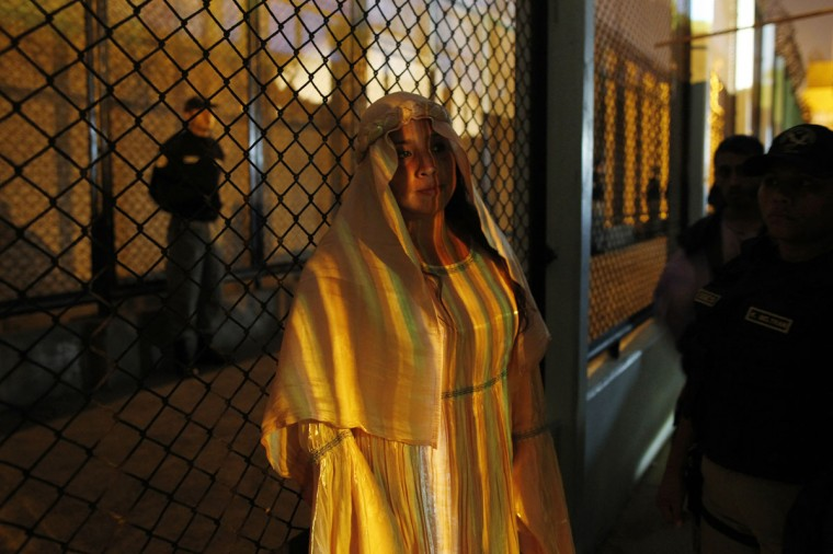 "An inmate prepares to enter on stage during the theatre play ""Jesus Christ Superstar"" at Sarita Colonia prison yard. (REUTERS/Enrique Castro-Mendivil)"