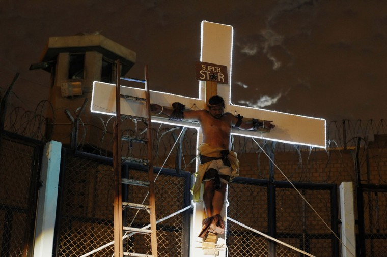 "An inmate depicting Jesus performs the crucifixion scene in the theatre play ""Jesus Christ Superstar"" at Sarita Colonia prison yard. (REUTERS/Enrique Castro-Mendivil)"