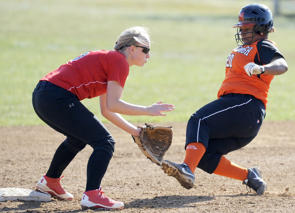 McDonogh's Jordan Vaughn, right, slides safely into second base as Dulaney shortstop Brooke Wall covers in the fourth inning of a high school softball game in Owings Mills Tuesday, April 1. (Steve Ruark/BSMG)