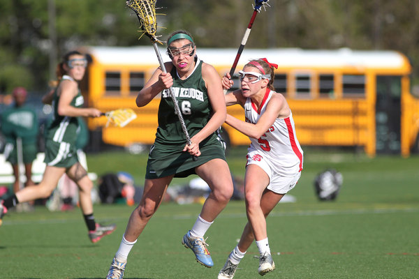 Friends' Abigail Corkum, right, defends Seton Keough's Mary Angela Bands, left, during the girls lacrosse game at Friends School in Baltimore on Wednesday, April 23. (Jen Rynda/BSMG)
