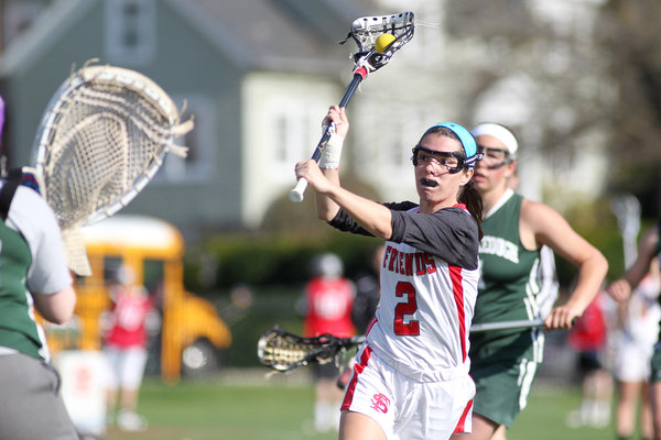 Friends' Caitlin Donovan looks to take a shot on Seton Keough during the girls lacrosse game at Friends School in Baltimore Wednesday, April 23. (Jen Rynda/BSMG)