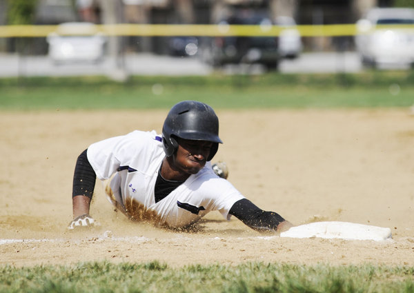 Mount. St. Joseph's Andre Brown slides safely into third base against Catonsville on Saturday, April 19. (Noah Scialom/BSMG)
