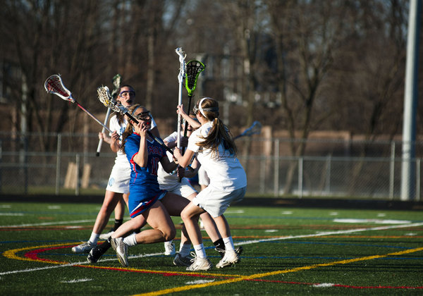 Centennial's Kay Kelly runs into a wall of Howard defenders during a game on April 1. (Noah Scialom/BSMG)