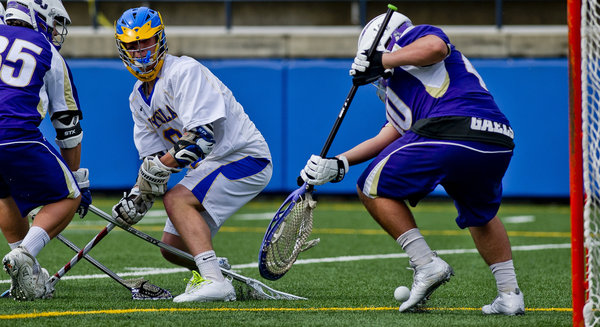 Loyola's Alex Roesner watches a low shot sail wide of Mt. St. Joe goalie Ben Heinzman during the lacrosse matchup between Mount St. Joseph's and Loyola at the Loyola-Blakefield Campus in Towson on Tuesday, April 22. (Scott Serio/BSMG)
