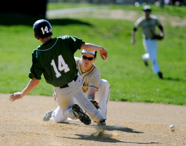 Mt. Hebron's Ian Reid, right, misses the throw to second as Atholton's Bryan Gsell slides into the bag for a stolen base during a game at Mt. Hebron High School in Ellicott City on Thursday, April 24, 2014. (Jon Sham/BSMG)For more photos from this game, click here.