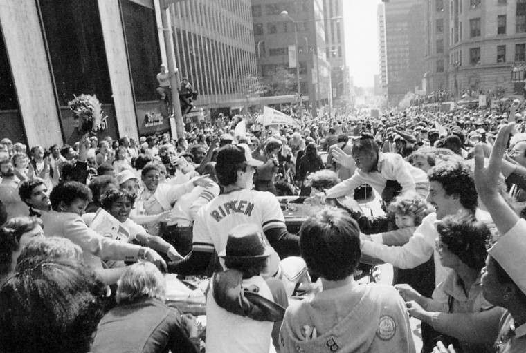 In October 1983, Orioles player Cal Ripken's car was surrounded by fans during the World Series victory parade through Baltimore. (Lloyd Pearson/Baltimore Sun)