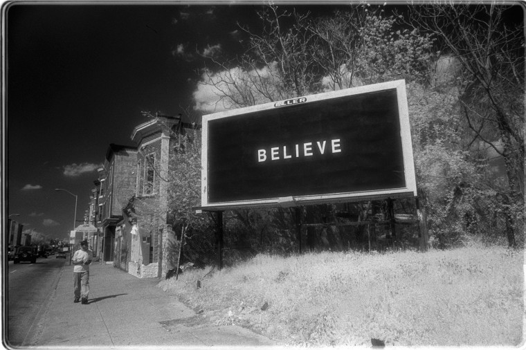 """BELIEVE"" campaign billboard on Greenmount Ave. (Infrared photo by Jerry Jackson/Staff)"
