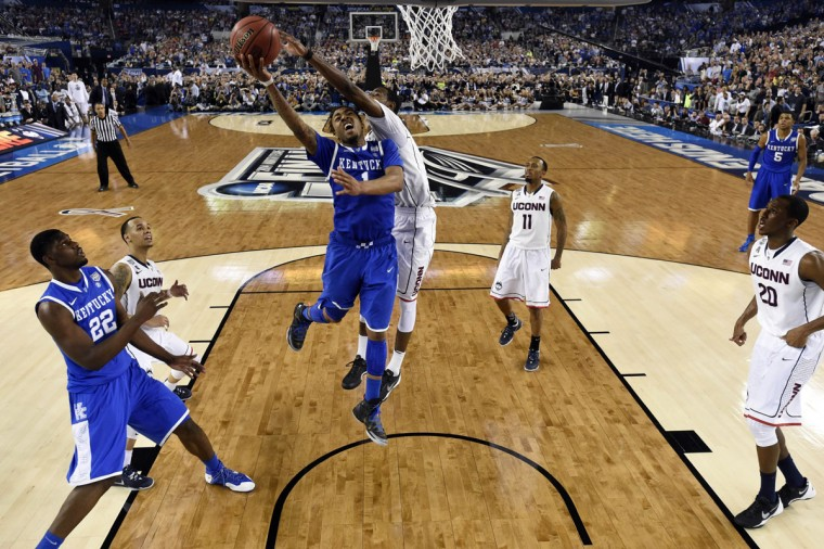 Kentucky Wildcats guard/forward James Young (1) shoots the ball against Connecticut Huskies forward DeAndre Daniels (2) in the second half during the championship game of the Final Four in the 2014 NCAA Mens Division I Championship tournament at AT&T Stadium. (USA TODAY Sports)