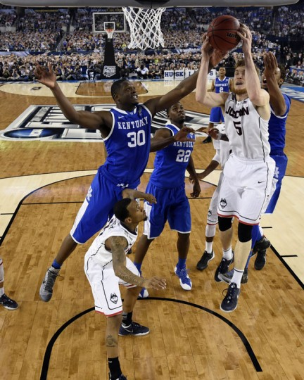 Connecticut Huskies guard/forward Niels Giffey (5) grabs a rebound in front of Kentucky Wildcats forward Julius Randle (30) in the second half during the championship game of the Final Four in the 2014 NCAA Mens Division I Championship tournament at AT&T Stadium. (USA TODAY Sports)