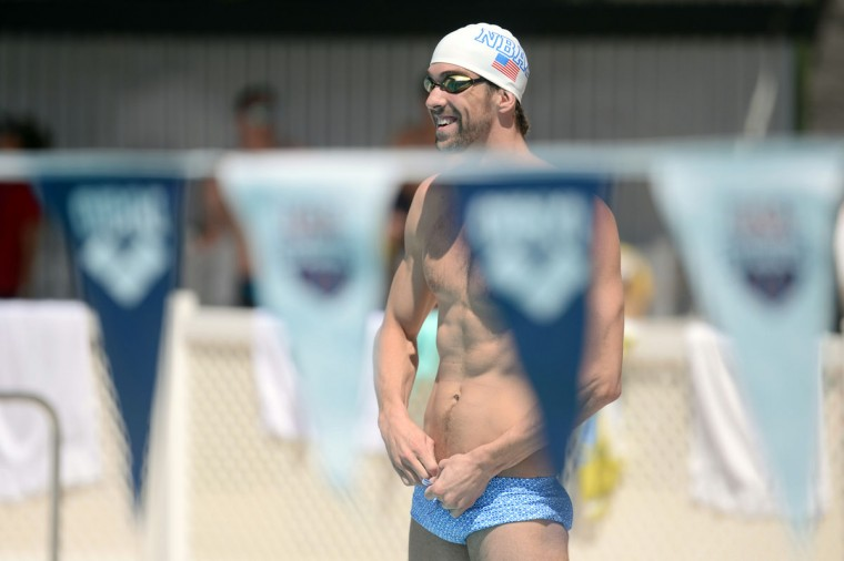 Michael Phelps warms up before participating in the 2014 USA Swimming Grand Prix Series at Skyline Aquatic Center. (Joe Camporeale-USA TODAY Sports)