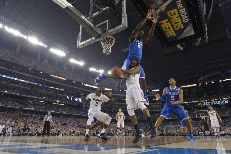 Kentucky Wildcats forward Alex Poythress (22) flips over Connecticut Huskies guard/forward Lasan Kromah (20) in the second half during the championship game of the Final Four in the 2014 NCAA Mens Division I Championship tournament at AT&T Stadium. (Bob Donnan-USA TODAY Sports)