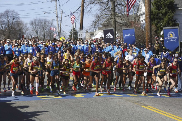 Athletes from the elite women field start during the 118th running of the Boston Marathon in Hopkinton, Massachusetts, April 21, 2014. (REUTERS/Dominick Reuter)