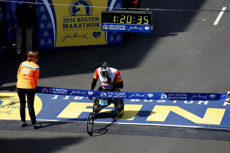 Ernst van Dyk finishes first in the men's wheelchair division of the 2014 Boston Marathon. (Greg M. Cooper-USA TODAY Sports)