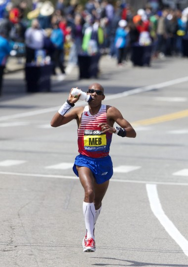 Winner Meb Keflezighi takes a drink from a bottle during the 2014 Boston Marathon. (David Butler II-USA TODAY Sports)