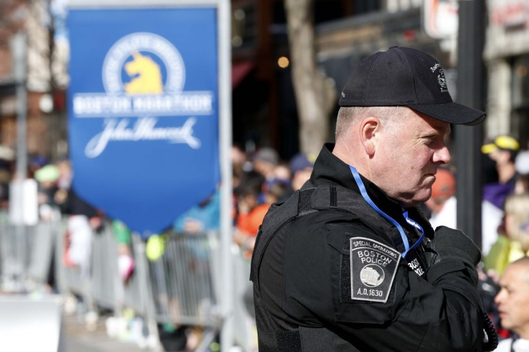 A Boston police officer from the special operations unit patrols Boylston Street near the finish line before the start of the 2014 Boston Marathon. (Greg M. Cooper-USA TODAY Sports)