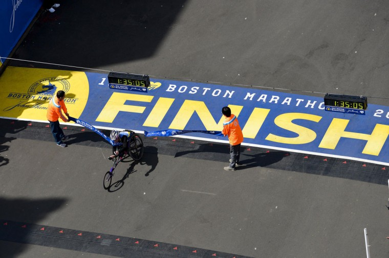 Clarksville native Tatyana McFadden crosses the finish line of the 2014 Boston Marathon on Boylston Street, taking first place in the women's wheelchair division. (Greg M. Cooper-USA TODAY Sports)