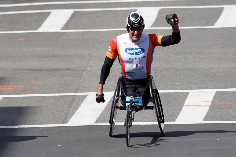 Ernst van Dyk reacts after finishing first in the men's wheelchair division of the 2014 Boston Marathon. (Greg M. Cooper-USA TODAY Sports)