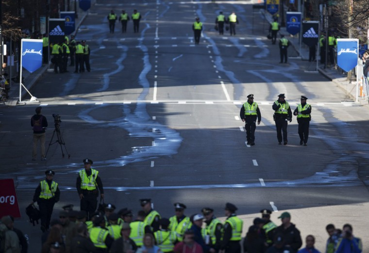 A heavy police presence stand guard in Boylston Street near the finish line of the Boston Marathon. (REUTERS/Gretchen Ertl)